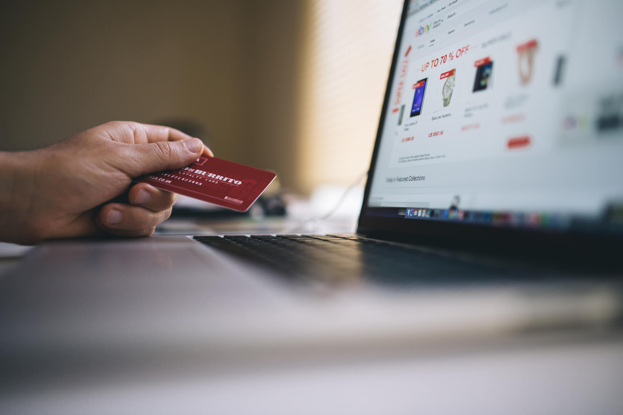 E-commerce Conversion Hacks - Buying with Credit Card on Computer