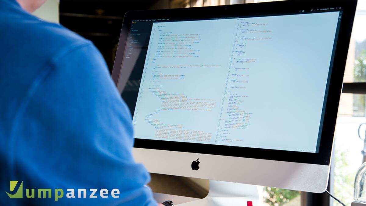 Website Designer Working at Desk
