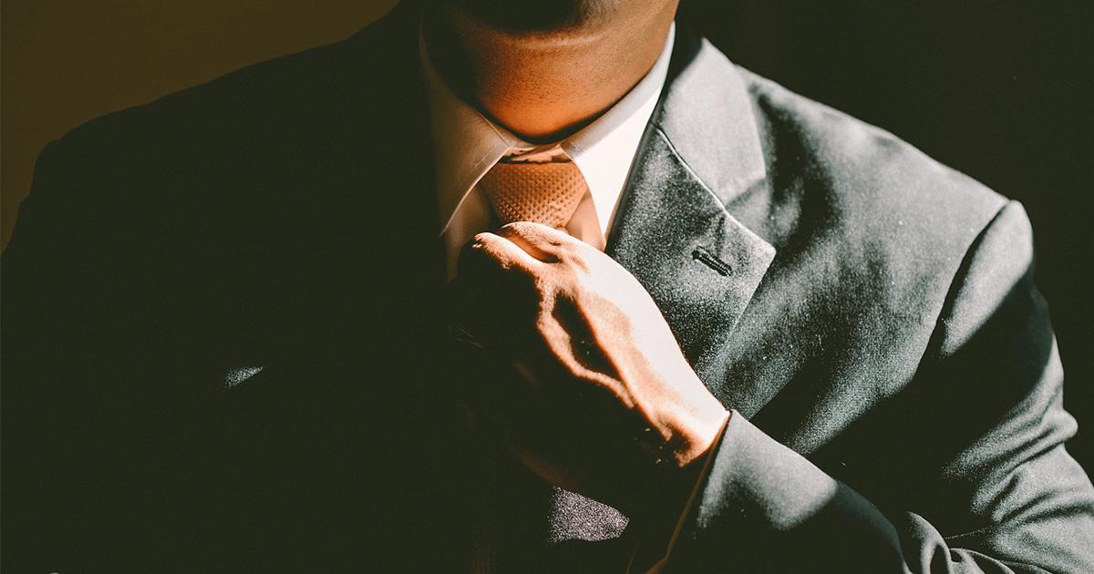 Secrets of Successful Entrepreneurs - Man Straightening Tie