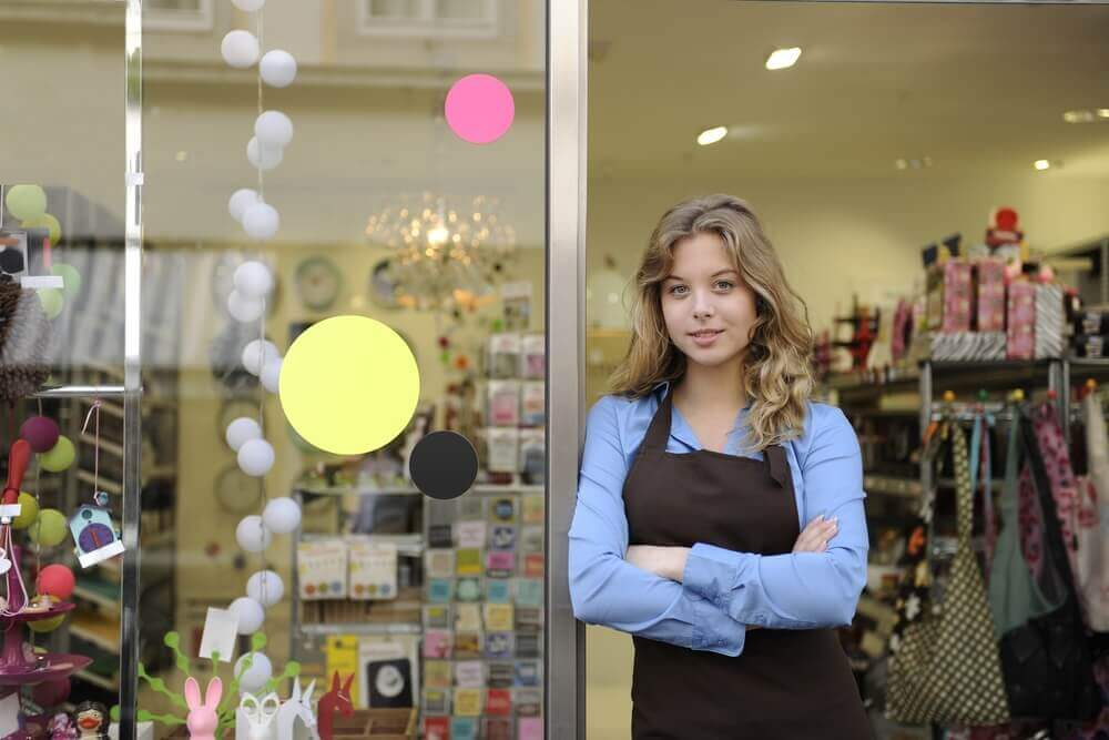 Expanding Your Small Business - Woman Business Owner Outside Store