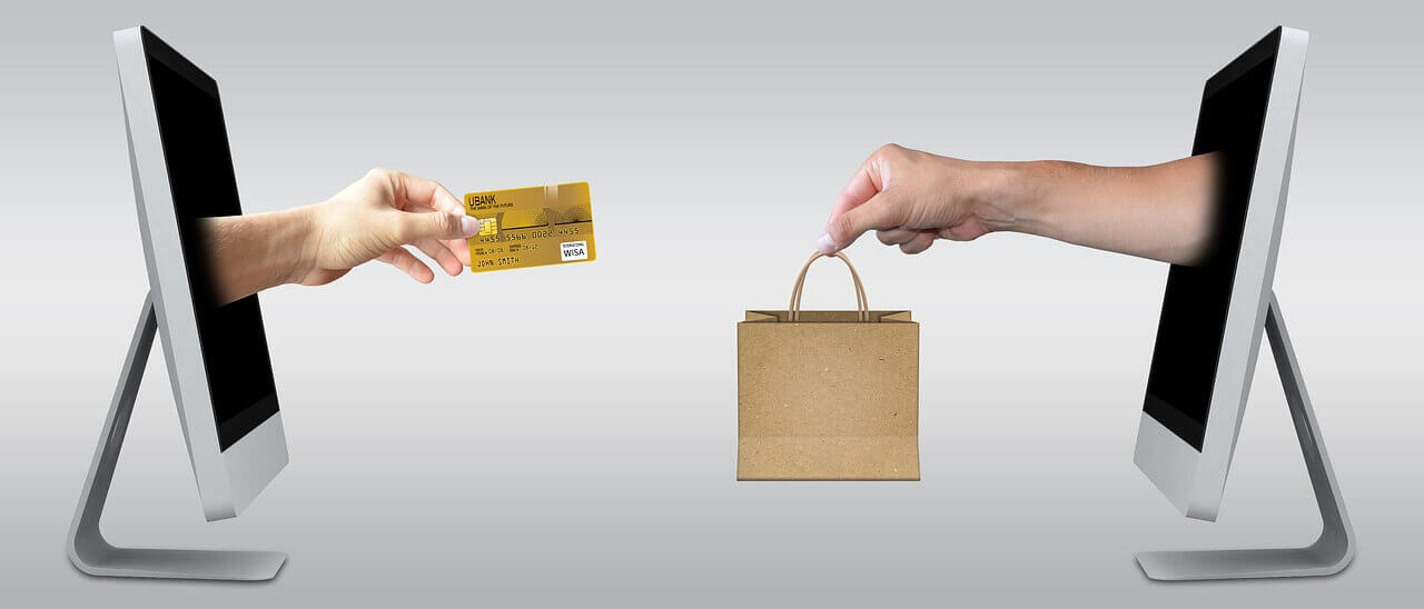 What You Need to Accept Credit Cards Checklist - 2 Computers with Credit Card and Shopping Bag