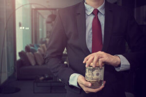 Key Signs You May Be Heading For Bankruptcy And Not Even Know It - Business Man Holding Cash