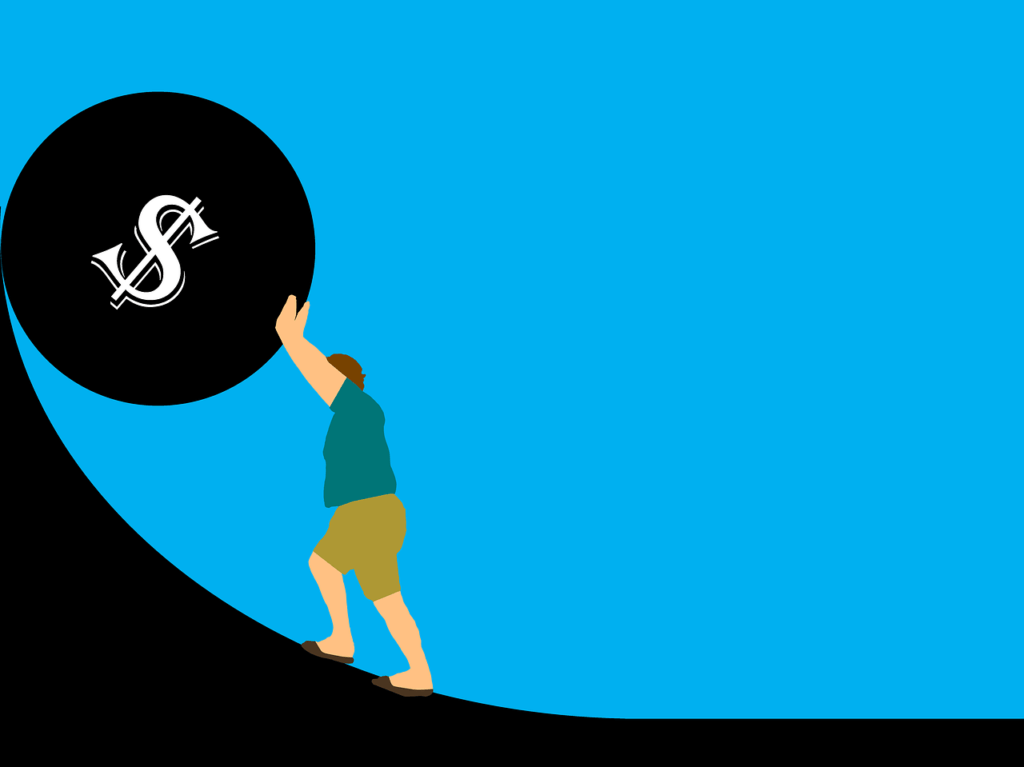Key Signs You May Be Heading For Bankruptcy And Not Even Know It - Man Pushing Ball Uphill